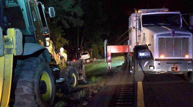 Semi-truck hauling cars blows tire, crashes into trees near Wilson