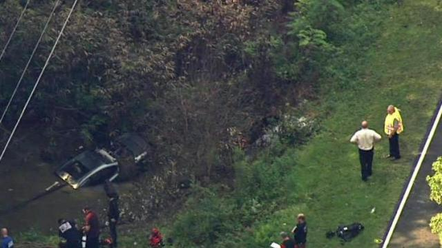 Crews responding to vehicle submerged in Fuquay pond