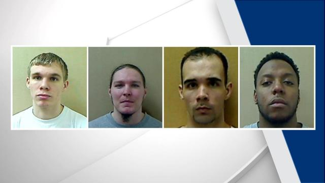 Four inmates charged with guards' murders in deadly attempted prison escape
