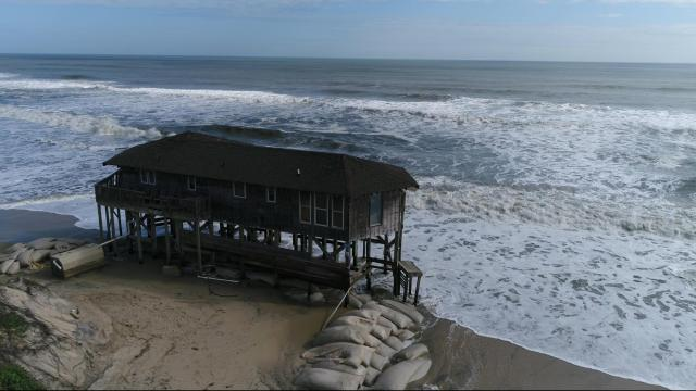 Some homes along the Outer Banks sit empty due to sea level rise