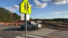 IMAGE: New sign installed one day after Apex high school student was struck by car in crosswalk