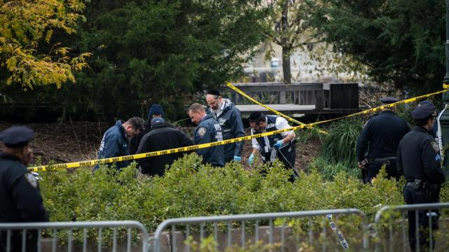 Members of a Jewish Orthodox emergency response and recovery team work with police investigators to search for remains to ensure for proper burial of victims, along a bicycle path where a driver in pickup truck plowed through, killing eight people and injuring 11, along the Hudson River in Manhattan, Nov. 1, 2017. Police have identified the driver as Sayfullo Saipov, 29, and said he had been planning the attack for weeks and appeared to have connections to people who were the subjects of terrorism investigations. (Todd Heisler/The New York Times)