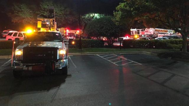WRAL TV firefighters in parking lot