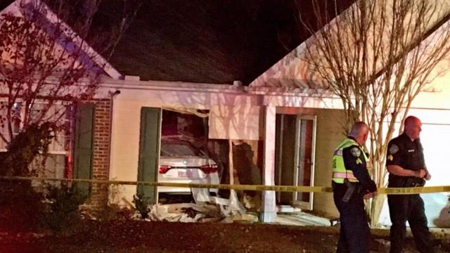 Child injured after car crashes into Apex home
