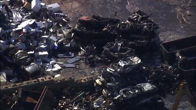 Several vehicles were damaged by a fire Wednesday morning at a metal recycling yard in Durham.