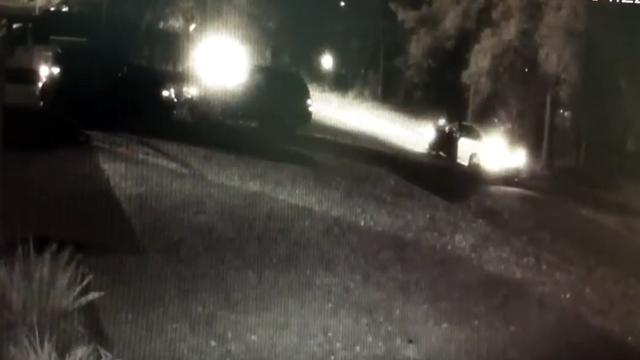 A frame from a security camera footage shows people opening fire on a vehicle on Old Oxford Highway in Durham on Nov. 16, 2017, killing a man.