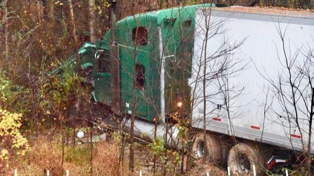A truck hauling strawberries crashed Wednesday morning off the side of Interstate 95 near Kenly.