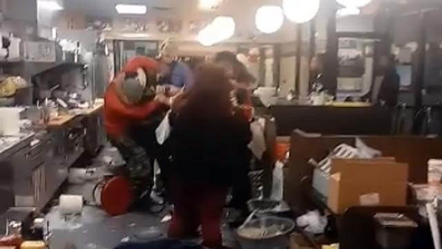 A still image from a Facebook video shows a fight inside a Waffle House restaurant in Fayetteville on Dec. 25, 2017.