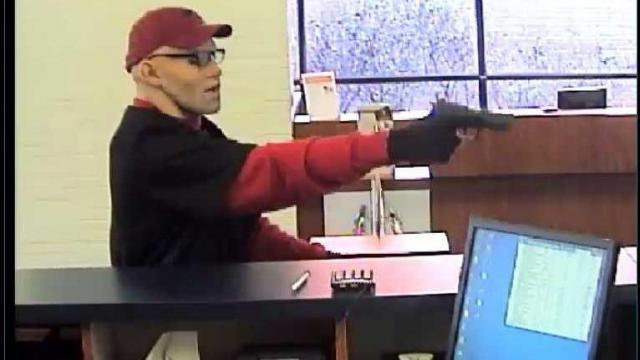 Authorities are searching for four bank robbery suspects who fired at Lumberton police officers following a chase Tuesday afternoon.