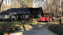 IMAGES: Family escapes but pet dog killed during Apex house fire