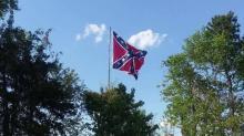 IMAGES: Confederate flag rises in Orange County