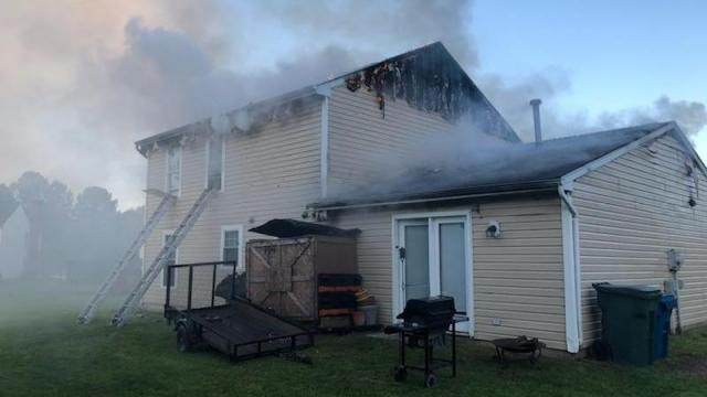 Woman trapped in Durham house fire
