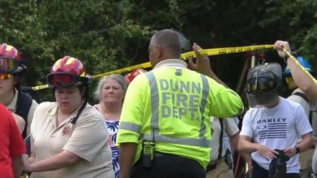 Emergency crews rescue man trapped 25 feet below ground in Dunn well