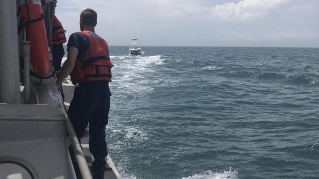 Coast Guard, good Samaritan rescue 3 people from fishing boat