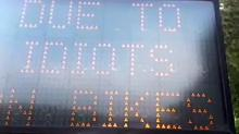 IMAGES: Along Ironman route, signs hacked to insult 'idiots on bikes'