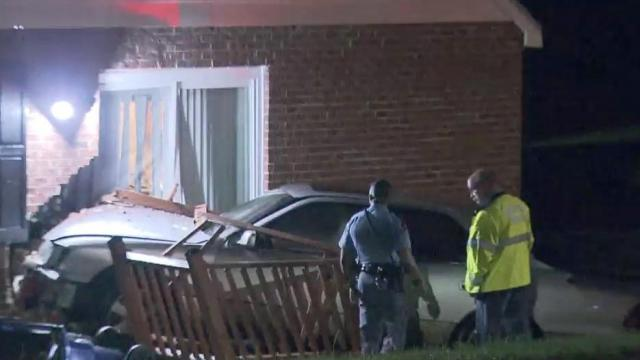 Car crashes into Raleigh home