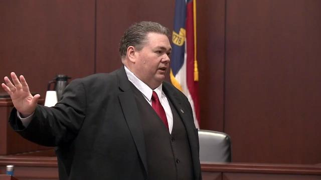 Wallace Bradsher, former district attorney for Person and Caswell counties, makes the opening statement in his fraud trial on June 4, 2018.