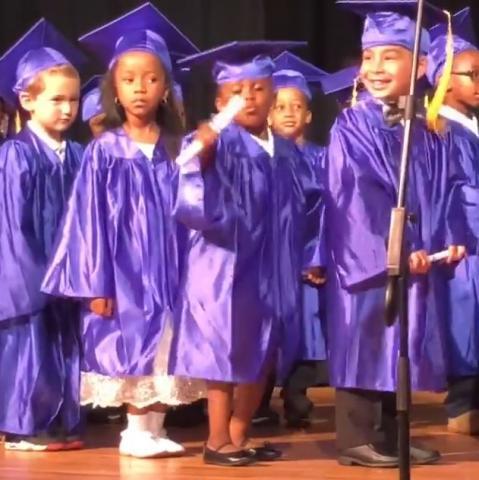 Little girl dances at graduation
