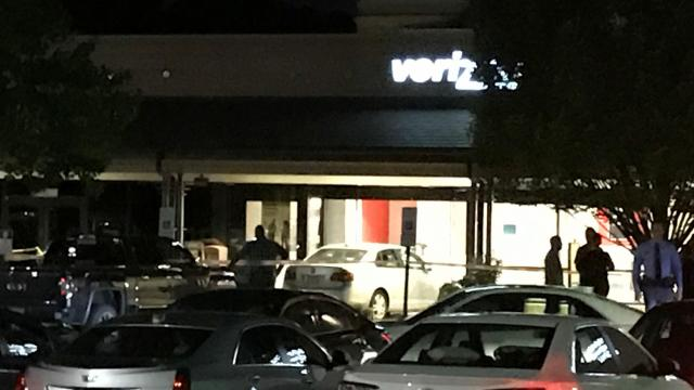 Man in custody after car crashes into Raleigh Verizon store