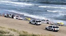 IMAGE: Seven members of family rescued from rip currents in Emerald Isle