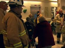Investigators search for cause of high-rise fire