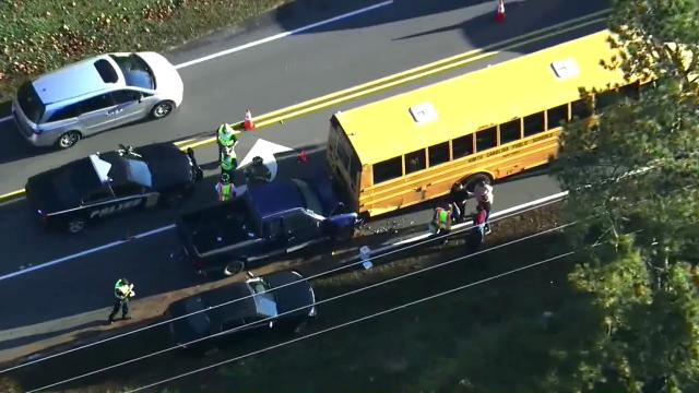 Truck rear-ends school bus in Wake Forest