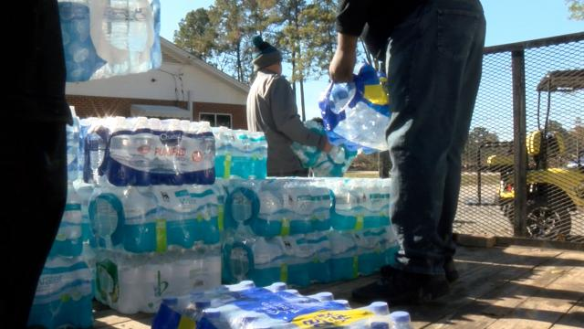 A truckload of bottled water was distributed to Lucama residents, who have complained for years about smelly, brown water coming from their taps, on Nov, 10, 2018.