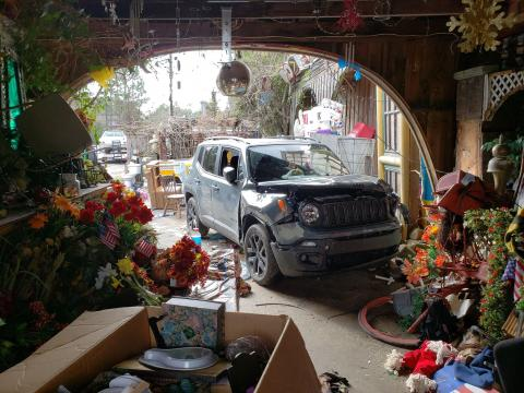 SUV slams into well-known junkyard, hitting three people