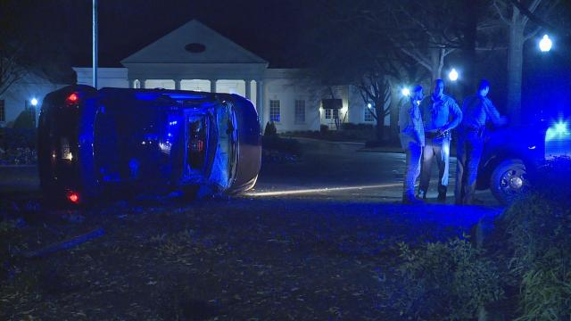 Police say the vehicle popped a curb and lost control on Glenwood Avenue in Raleigh.