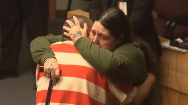 Tina Martinez hugs Armando Martinez
