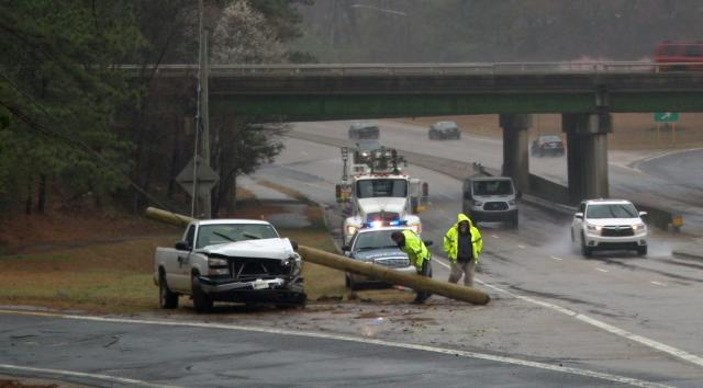 Hydroplaning truck brings down utility pole on Western Boulevard