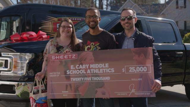 Big surprise! Cary track coach gifted with new truck, $2,500 donation