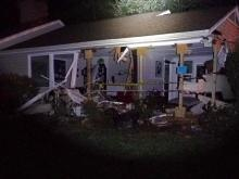 Car hits power pole, runs into house in Raleigh