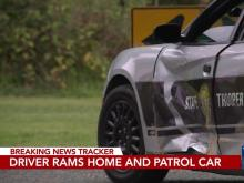 Woman rams into house, highway patrol vehicle
