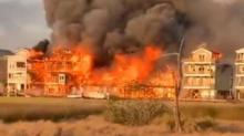 IMAGES: Massive fire engulfs several Surf City homes