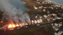 IMAGES: PHOTOS: Massive fire rips through Surf City complex