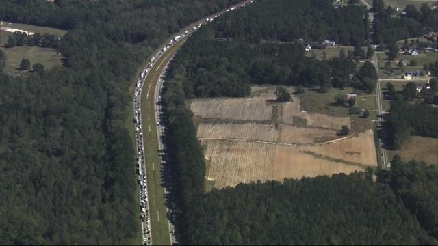 Truck carrying crates of chickens crashes on US 264 in Wake County