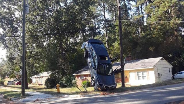 A stolen car was left vertical after an Oct. 12, 2019, crash on Milburnie Road. (Photo courtesy of Gary Antwon Williams)