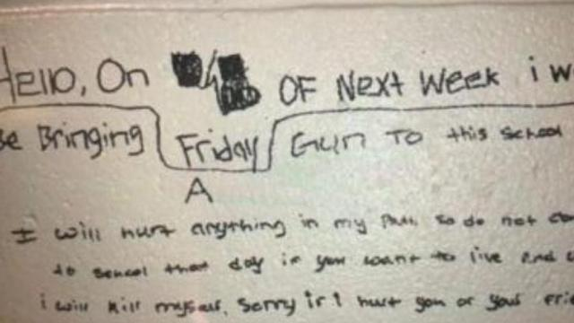 A message scrawled on the wall of Apex High School that apparently threatened violence.