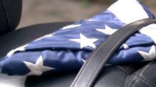 IMAGES: Through Facebook, flag is found and returned to veteran