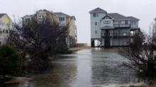 IMAGES: Sand overwash, flooding closes NC 12 in Outer Banks, suspends all ferry routes