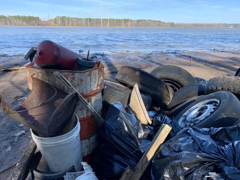 Falls Lake with a pile of trash in front of it