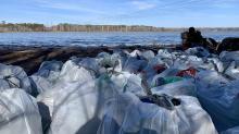 IMAGES: Hidden field of trash at Falls Lake represents decade of litter