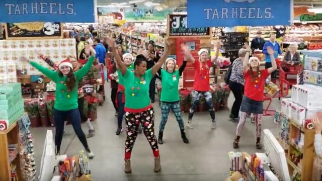 Trader Joe's employees treat shoppers to holiday show. Photo from YouTube.
