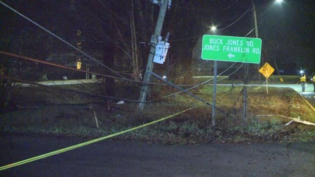 Car crashes into tree near Western Boulevard, brings down power lines