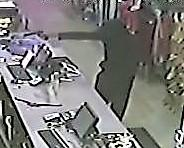 Surveillance video still: Plato's Closet armed robbery
