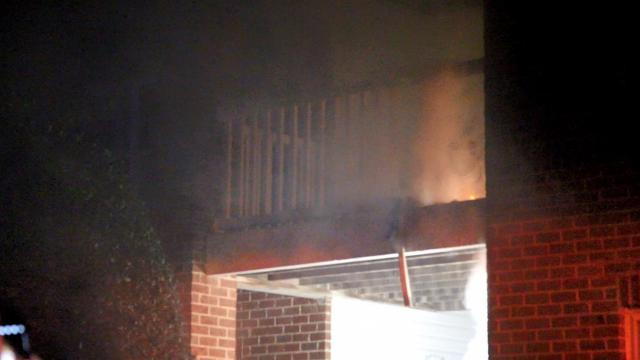 Flames on a deck at an apartment in Holly Springs.