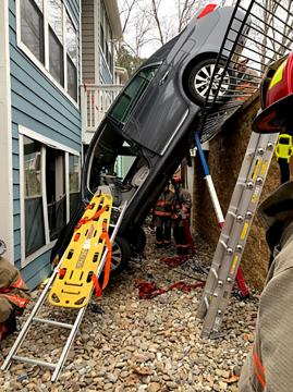 Car gets stuck after crashing through 10-foot retaining wall at Durham apartment complex.