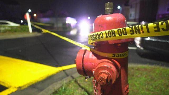 Crime scene tape around fire hydrant