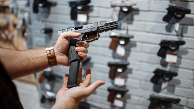 Someone loading a handgun
